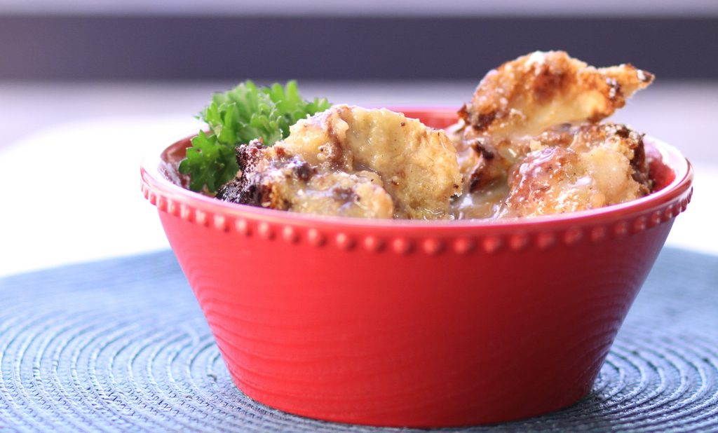 close up of bread pudding in a red bowl