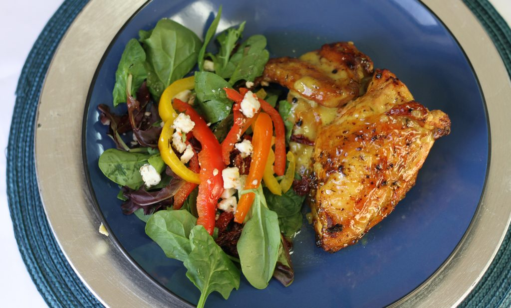 wings and a small salad with bell peppers